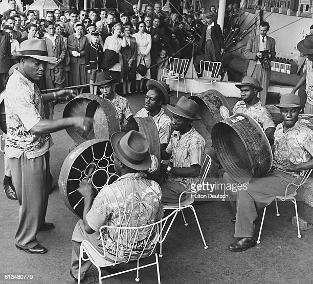 The Trinidad All Steel Percussion Orchestra gives its first public performance in London at the South Bank under the leadership of their Manager...