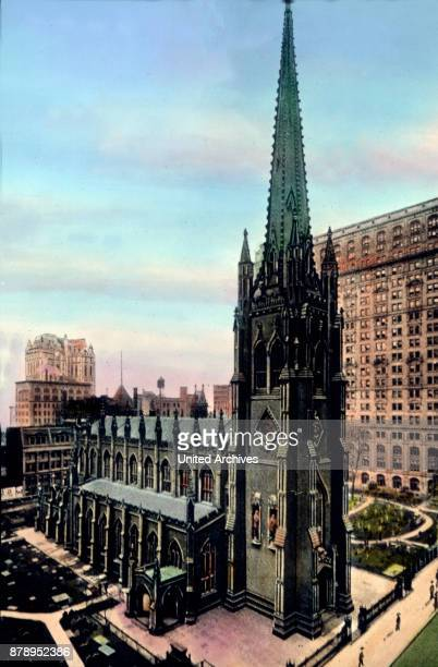 The Trinity Church in the immediate proximity to Wall Street in New York
