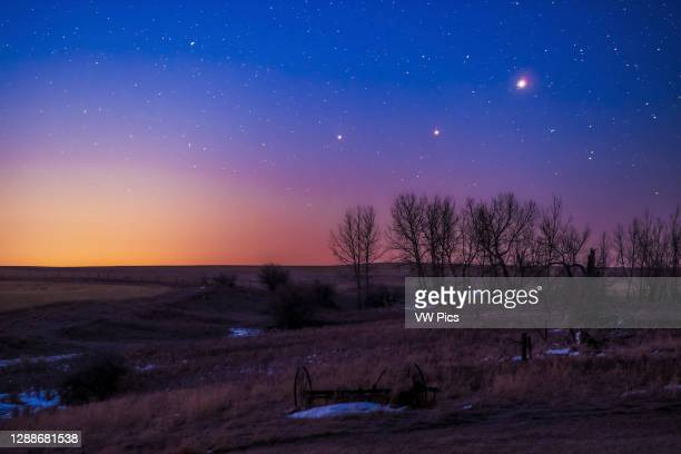 The trio of Saturn, Mars and Jupiter in conjunction in the dawn twilight, taken from home in Alberta on March 26, 2020. This is a stack of 10...