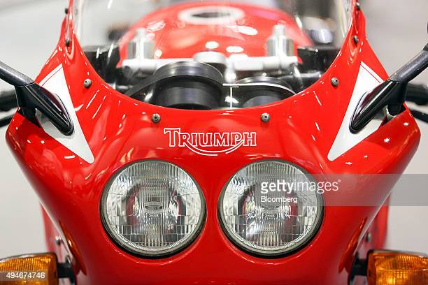 The Triumph company logo is displayed on the front of a motorbike made by Triumph Motorcycles Ltd in London UK on Wednesday Oct 28 2015 Triumph...