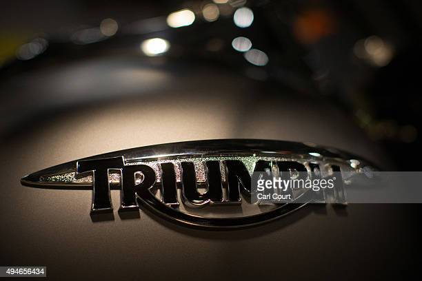 The Triumph logo is displayed on a Triumph motorcycle on October 28 2015 in London England British motorcycle manufacturer Triumph have unveiled five...