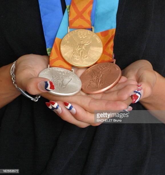 The Triumph Of Laure Manaudou At Athens Olympic Laure MANAUDOU triple médaillée olympique aux Jeux olympiques d'Athènes 2004 pose en exclusivité pour...