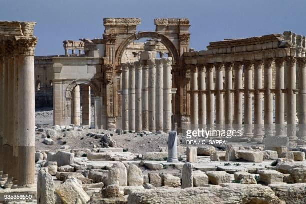 The triumphal arch of Septimius Severus and the main colonnaded street of Palmyra , near Tadmur, Syria. Roman civilisation, 1st-2nd century AD.