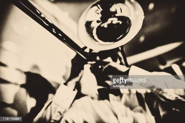 the trombone player - jazz stock pictures, royalty-free photos & images