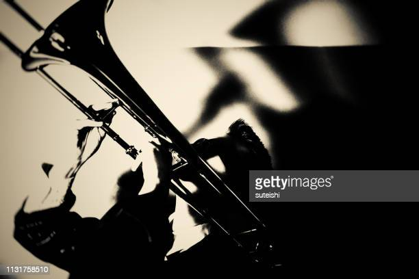 the trombone player - of jazz musicians stock pictures, royalty-free photos & images