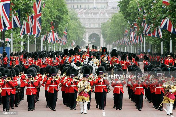 The Trooping The Colour procession along The Mall accompanied by the Household Division of Guardsmen in traditional bearskin hats and uniforms is...