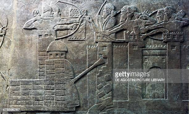 The troops of the Assyrian king Ashurbanipal attack a city with archers and war machines relief from the palace of Nimrud Iraq Assyrian civilisation...