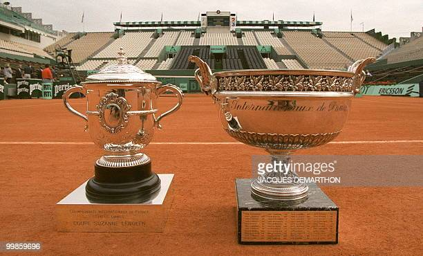 The trophies for the French Open men's and women's singles competition are seen 06 June on Center Court at the Roland Garros stadium in Paris. The...
