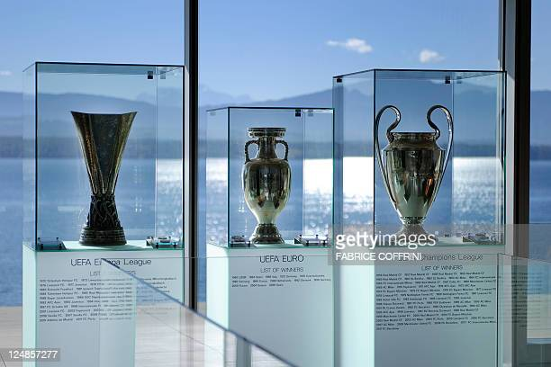 The trophies of UEFA Europa League, Euro and Champions League are displayed at the UEFA Headquaters on September 13, 2011 in Nyon. AFP PHOTO /...