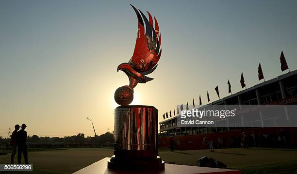 The trophy beside the green on the 18th green as the final group putt out during the final round of the 2016 Abu Dhabi HSBC Golf Championship at the...
