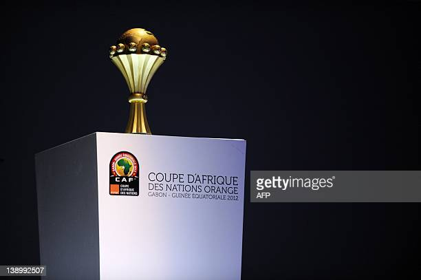 The trophy for the African Nations football Cup is seen on stage during a draw ceremony in Malabo on October 29 2011 The top football competition of...