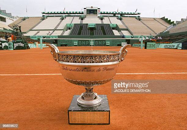The trophy for the French Open men's singles competition is seen 06 June on Center Court at the Roland Garros stadium in Paris The Mousquetaires Cup...
