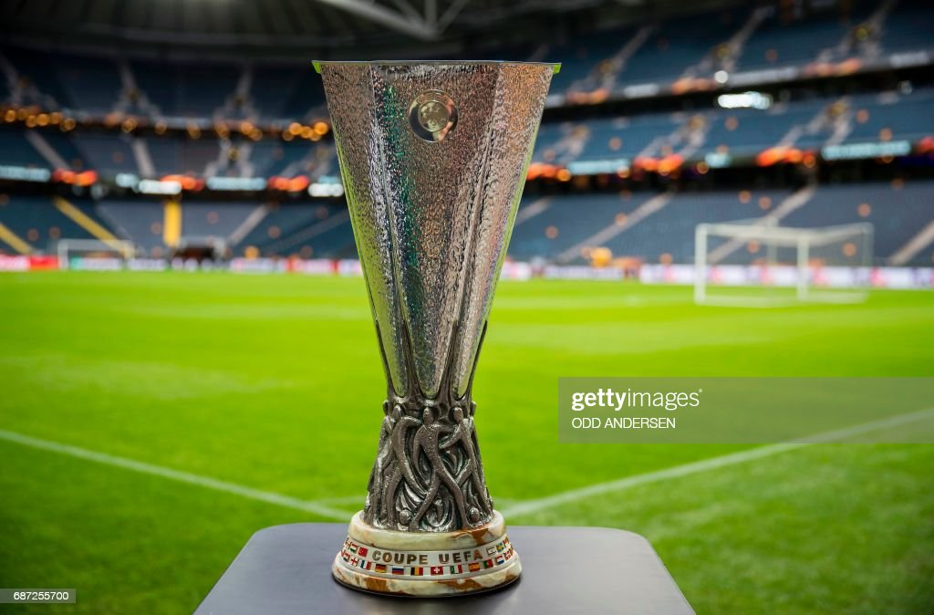 TOPSHOT - The trophy is on display next to the pitch at the Friends Arena in Solna outside Stockholm on May 23, 2017, on the eve of the UEFA Europa League football final between Ajax Amsterdam and Manchester United. / AFP PHOTO / Odd ANDERSEN
