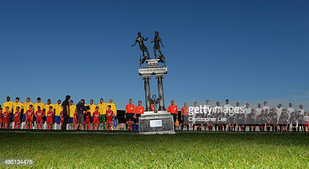 The trophy is seen on the pitch as both teams line up before kick during the Final of the Toulon Tournament between France and Brazil at the Parc des...