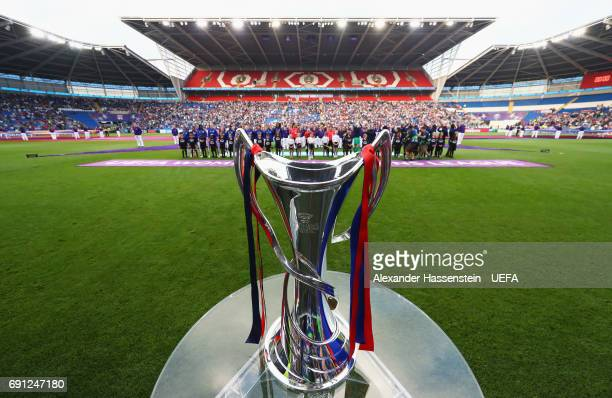 The trophy on display as players officials and player escorts line up prior to during the UEFA Women's Champions League Final between Lyon and Paris...