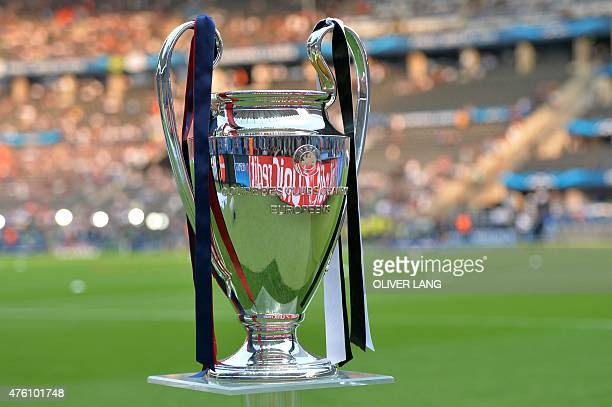 The trophy stands on the pitch prior to the UEFA Champions League Final football match between Juventus and FC Barcelona at the Olympic Stadium in...