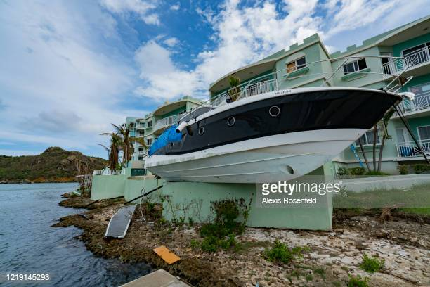 The tropical storm caused catastrophic damage as here where boat are found either beached on land along road on November 08 SaintMartin French West...