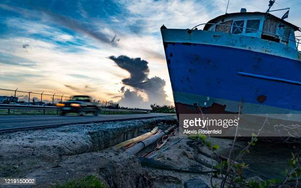 The tropical storm caused catastrophic damage as here where boat are found either beached on land along road on November 06 SaintMartin French West...