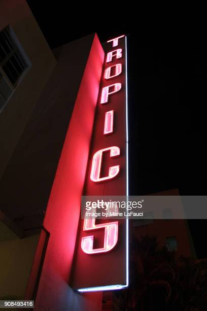 the tropics hotel sign, miami beach art deco building - fauci stock pictures, royalty-free photos & images