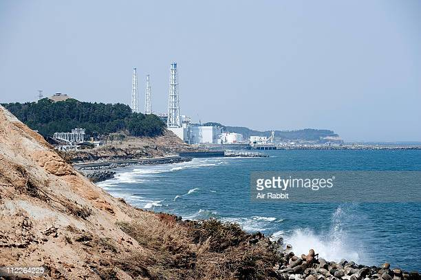 The troubled Fukushima Daiichi Nuclear Power Plant is seen 25km south from the plant on April 15 2011 in Okuma Fukushima Japan Japanese government...