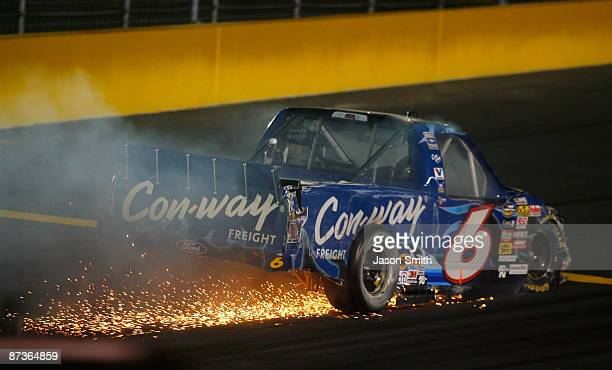 The truck of Colin Braun driver of the ConWay Freight Ford sparks after crashing during the NASCAR Camping World Series North Carolina Education...