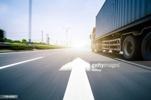 the truck was driving on the highway - lkw stock-fotos und bilder