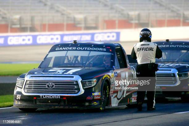 The trucks are brought to pit road for a late race red flag during the 11th running of the Ultimate Tailgating 200 NASCAR Gander Outdoors Truck...