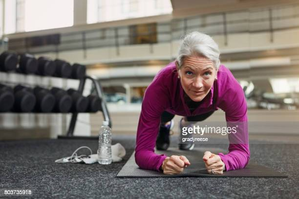 the true definition of fit and fierce - active senior woman stock photos and pictures