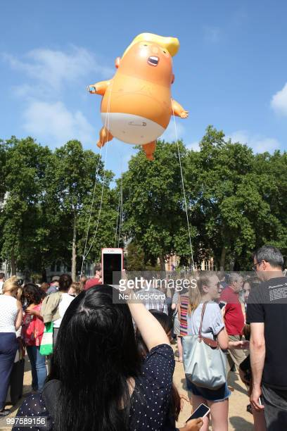 The 'Trump Baby' blimp a six meterhigh heliumfilled effigy of US President Donald Trump flies over Parliament Square in London UK on Friday July 13...