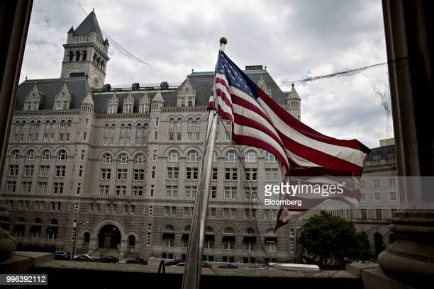 The Trump International Hotel stands past an American flag flying outside the Environmental Protection Agency headquarters in Washington DC US on...