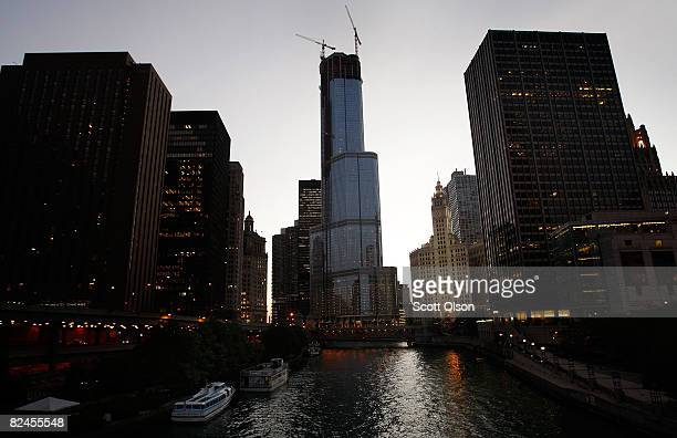 The Trump International Hotel Tower rises above the city's business district August 18 2008 in Chicago Illinois The 92story hotel and condominium...