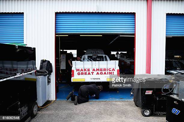 The Trump Pence 2016 Toyota driven by Austin Wayne Self sits in teh garage during practice for the NASCAR Camping World Truck Series fred's 250 at...