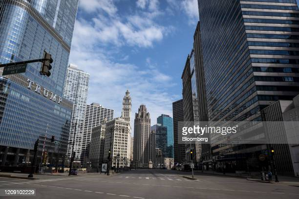 The Trump Tower stands on a near-empty Wacker Drive in Chicago, Illinois, U.S., on Friday, April 3, 2020. The world's workers are reeling from the...