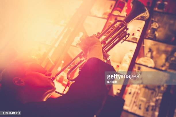 the trumpet player at the jazzclub - jazz stock pictures, royalty-free photos & images