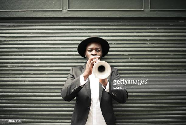 the trumpet player - musician stock pictures, royalty-free photos & images