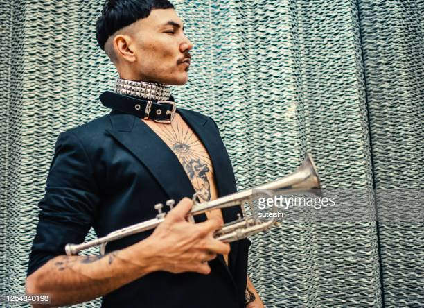 the trumpet player - punk music stock pictures, royalty-free photos & images