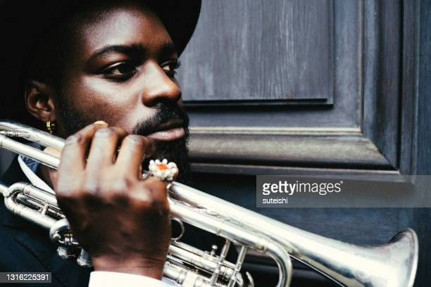 the trumpet player - african american culture stock pictures, royalty-free photos & images