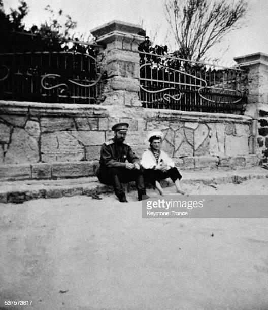 The Tsar Nicolas II with his son Tsarevich Alexis Nikolaevich sitting on a march circa 1910 in Russia