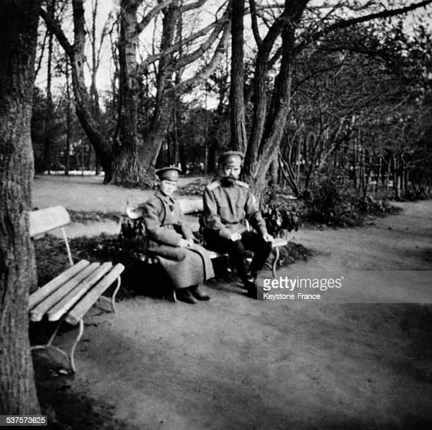 The Tsar Nicolas II with his son Tsarevich Alexis Nikolaevich sitting on bench circa 1910 in Russia