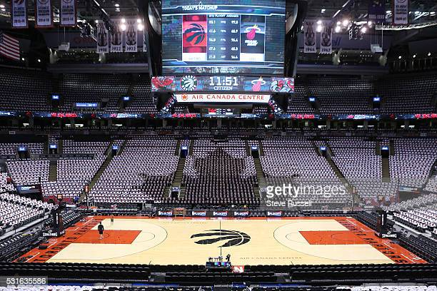 The tshirt scheme in the arena is a black maple leaf on white composed of bleeding basketballs as the Toronto Raptors play the Miami Heat in game...