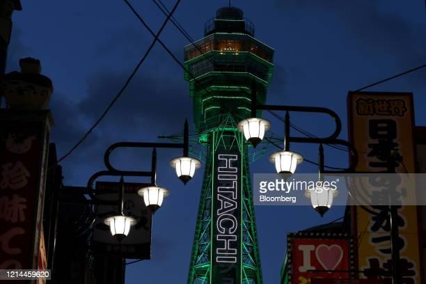 The Tsutenkaku Tower stands illuminated at night in the Shinsekai district of Osaka, Japan, on Thursday, May 21, 2020. Japan's Prime Minister Shinzo...