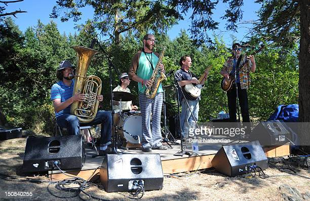The tuba player drummer saxophone guitar and bass players of The Dust Bunnies perform at Doe Bay Music Festival on August 11 2012 in Orcas Island...