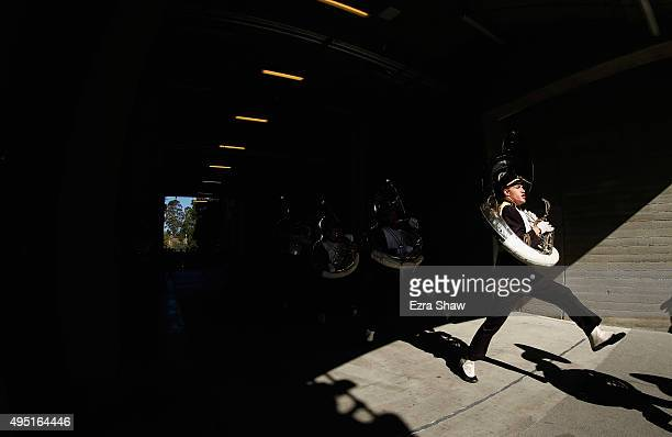 The tuba section of the USC Trojans marching band walks onto the field for their game against the USC Trojans at California Memorial Stadium on...