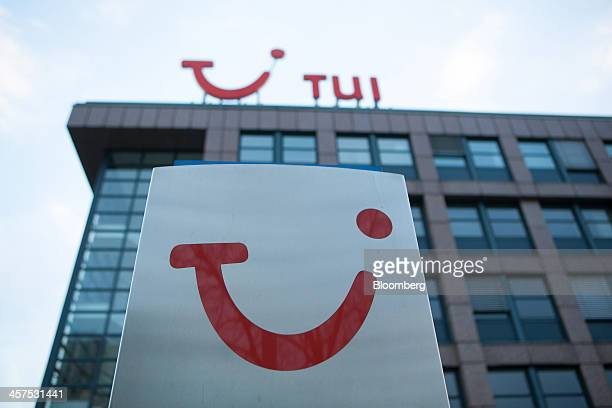 The TUI logo sits on a sign outside TUI AG's headquarters in Hamburg, Germany, on Wednesday, Dec. 18, 2013. TUI AG, Europe's largest tour operator,...