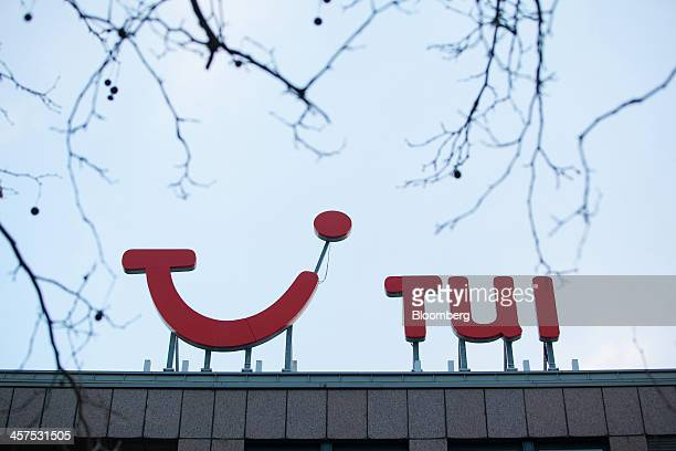 The TUI logo sits on top of TUI AG's headquarters in Hamburg, Germany, on Wednesday, Dec. 18, 2013. TUI AG, Europe's largest tour operator, reported...