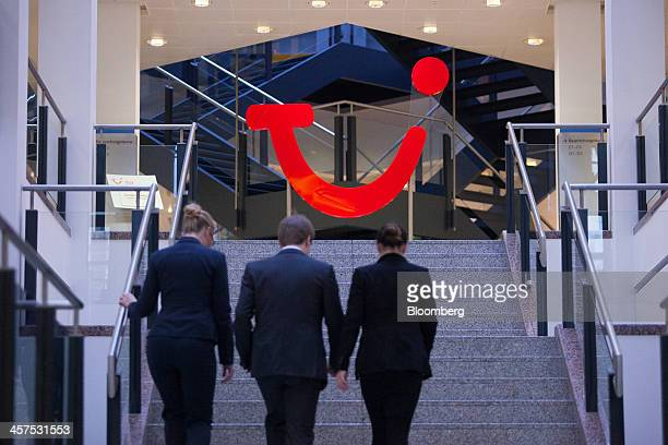 The TUI logo stands in the reception area of TUI AG's headquarters in Hamburg, Germany, on Wednesday, Dec. 18, 2013. TUI AG, Europe's largest tour...