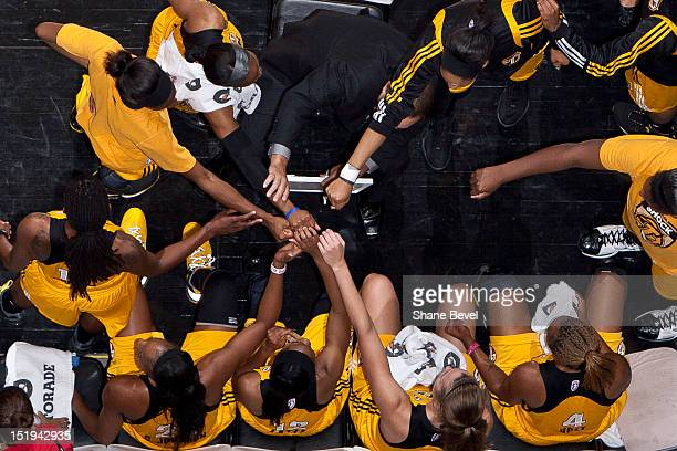 The Tulsa Shock huddle up around coach Gary Kloppenburg during a time out in the WNBA game on September 12 2012 at the BOK Center in Tulsa Oklahoma...