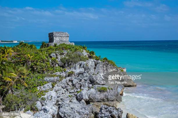the tulum ruins in the caribbean in mexico's mayan riviera, quintana roo, mexico - mayan riviera stock photos and pictures