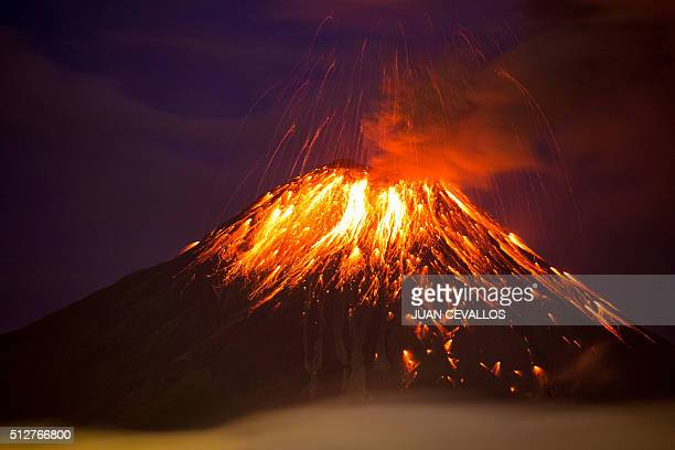 TOPSHOT The Tungurahua volcano spews fumes and lava on February 27 2016 in Huambalo Ecuador affecting neighboring parishes with ashfall / AFP / Juan...