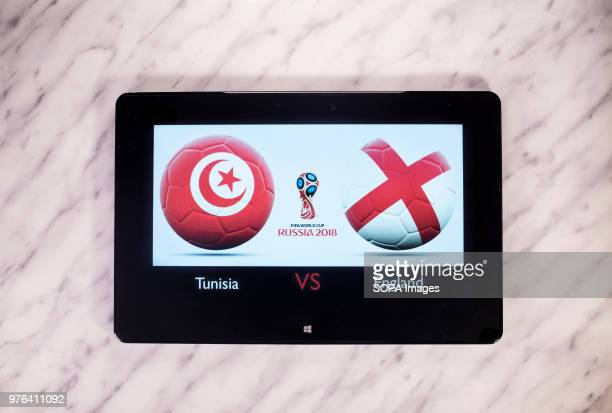 The Tunisian and English flags seen together with the Russian 2018 World cup logo displayed on a tablet This game belongs to first match up from...